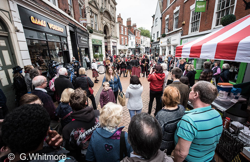 An image of a busy street with music and dance at Derby Folk Festival